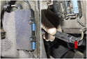 Working behind front strut, open plastic door (blue arrows) for brake pad wear sensor electrical connector.