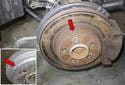 Most factory rotors and some aftermarket rotors will have a minimum thickness stamped on the rotor (red arrow).