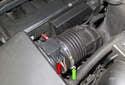 Loosen the air flow meter clamp (green arrow).