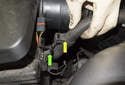 Pull the wiring harness (yellow arrow) off the mount on the intake air housing (green arrow).