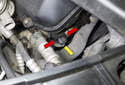 Exhaust camshaft sensor: Working at the right front of the cylinder head, disconnect the camshaft sensor electrical connector by pressing the release tabs (red arrow) and pulling it straight off in the direction of the yellow arrow.