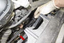 Rotate the engine clockwise by hand using a 22mm socket and ratchet on the crankshaft pulley bolt (red arrow).