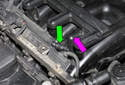 Working at center of intake manifold, squeeze release tab and pull pipe (green arrow) off crankcase breather pipe (purple arrow).