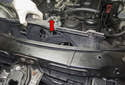 Lift the cooling fan straight up (red arrow), push it toward the right of the vehicle, be sure it clears the radiator reservoir.