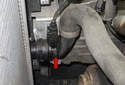 The radiator outlet temperature sensor (red arrow) might be the cause of a hard to find coolant leak.