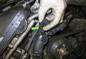 Working at the top of thermostat housing, locate the thermostat electrical connector.