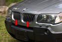 The radiator grilles consist of two grilles (red arrows) mounted in the front bumper cover.