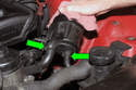 Lift the power steering reservoir up so you can access the hoses at the bottom (green arrows).
