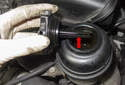 Bleeding the power steering pump: Before starting engine, fill the power steering reservoir with clean fluid to the MAX level on dipstick (green arrow).