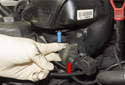 Working at front of intake manifold, pull evaporative emission purge solenoid (red arrow) off mounting bracket.