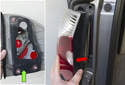 Then push tail light out of fender from inside the vehicle while supporting it from the outside (red arrow).