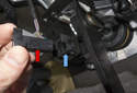 Remove brake light switch by sliding switch (red arrow) out of mounting bracket toward rear of vehicle (blue arrow).