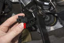 Once electrical portion of switch is removed, pull mount / adjuster (red arrow) out of mounting bracket by releasing tabs.
