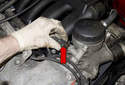 Remove hose (red arrow) from oil filter housing.