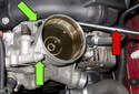 Lift the power steering reservoir up and lay aside (red arrow).