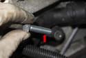 Remove the knock sensor fastener.