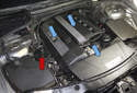 The ignition coil cover, the intake manifold cover and the intake air duct (blue arrows) all need to be removed in order to gain access to the valve cover.