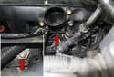 Working below the intake near the throttle housing mounting surface (red arrows), locate the intake manifold mounting bracket.