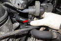 Working at the front of the intake manifold, pull the evaporative emission purge solenoid off the mounting bracket.