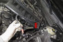If removing the manifold completely, feed the battery cable (red arrow) through the intake runners, note the position and orientation of the cable.