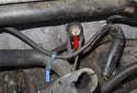 Next, cut the knock sensor harness tie strap (blue arrow).