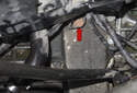 Then, follow the lower pipe the engine mount bracket and remove the lower pipe 13mm fastener (red arrow).