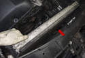 Next, pull the radiator out of the radiator support (red arrow).