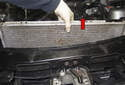 Lift the radiator up slightly and check for snagged hoses or electrical harnesses.