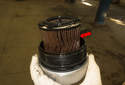 Remove the oil filter cover from the engine and remove the old oil filter from its cover.