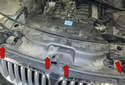 Start by removing the four T30 Torx fasteners (red arrows) for the fresh air plenum.