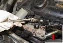 Using a 5/8 thin-wall spark plug socket on a 12 extension, remove the spark plug from the cylinder head.