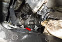 Then remove the thermostat from the front, over the subframe (red arrow).