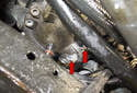 Then remove two remaining E12 fasteners at the bottom of the water pump (red arrows).