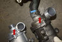 With the old water pump removed, install the hose on the new pump that connects to the rear of the pump as it was installed on the old pump.