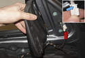 Mirror: Peel plastic trim back to expose the electrical connector (red arrow).