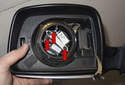Mirror motor: To replace the mirror motor, remove the three T15 Torx fasteners (red arrows).