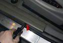 Inner trim: Using a trim panel prying tool, gently lever out the molding piece.