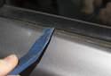 Lever it up starting at door handle end, working toward mirror.