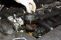 6-cylinder engine: Remove the oil filter cover from the engine and remove the old oil filter from the cover.
