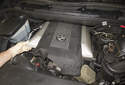 8-cylinder engine: Then lift the intake manifold engine cover off the engine to remove it.
