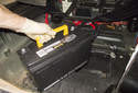 Replacing battery: Lift the battery up and remove it from the spare tire wheel well.