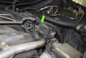 Locate the camshaft sensor electrical connector (green arrow).