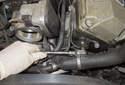 Remove the camshaft position sensor 5mm Allen fastener.