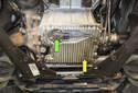 BMW E53 X5 models utilize an oil level sensor (green arrow located in the oil pan (yellow arrow).
