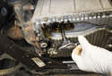 Remove the oil level sensor from the oil pan.