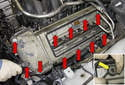 Remove the eleven 10mm fasteners from the perimeter of the valve cover (red arrows).