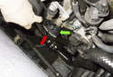 Remove the alternator drive belt (red arrow) and tensioner (green arrow).
