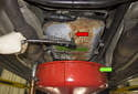 Place a drain pan (green arrow) under your transmission and remove the 8mm Allen fluid drain plug (red arrow).