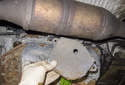 Then, remove the transmission range switch heat shield.