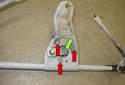 Next, remove the 13mm wiper motor lever fastener (green arrow).